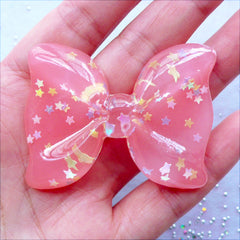 Big Bow Cabochon with Star Sprinkles | Translucent Resin Bow Cabochon with Confetti | Pastel Kei Decoden | Cell Phone Case Deco | Kawaii Chunky Jewelry Making (1 piece / Coral Pink / 54mm x 41mm / Flat Back)