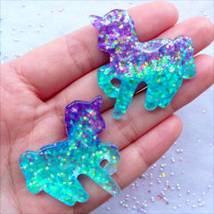 Unicorn Cabochon in Glittery Galaxy Color | Confetti Glitter Cabochon | Kawaii Cabochon Supplies | Fairy Kei Jewelry Making | Resin Decoden Pieces | Fairytale Embellishments (2pcs / Purple Aqua Blue / 36mm x 38mm / Flat Back)