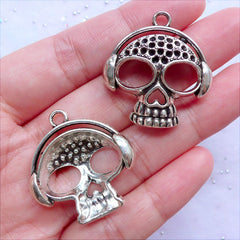 Silver Skull with Headphone Charms | Music Skull Pendant | Punk Rock Jewellery DIY | Spooky Skeleton DJ Charm (2 pcs / Tibetan Silver / 29mm x 31mm)