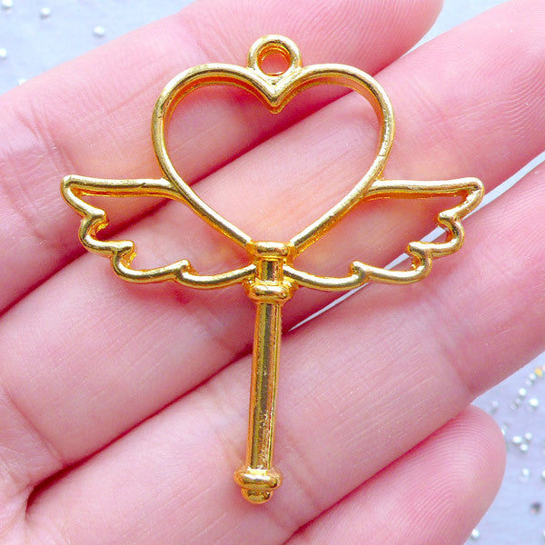 Winged Heart Wand Open Back Bezel Pendant | Mahou Kei UV Resin Jewelry Making | Magical Heart Wand Charm with Angel Wings (1 piece / Gold / 36mm x 40mm)