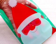 CLEARANCE Christmas Santa Claus Gift Bags / Plastic Cello Bags / Christmas Product Packaging Bag / Treat Bags / Favor Bags (14cm x 20cm / 20pcs) GB146
