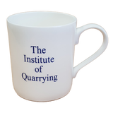 Back of white mug. White mug with Institute Of Quarrying written on it.