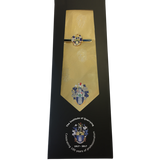 A golden coloured silk tie with the Institute of Quarrying logo on.