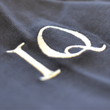 Closeup of IQ Logo on Vintage Navy Blue Rugby Shirt