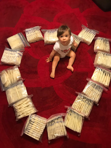 Trenton Cabral surrounded by Sabrina's breastmilk donation in the shape of a heart.