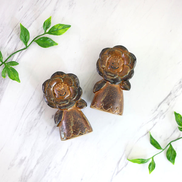 Vintage Stoneware Flower Faces Salt and Pepper Shakers