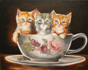 Kittens in a tea cup painting