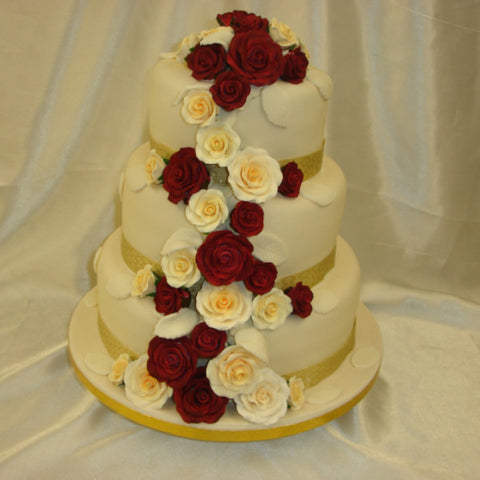 3 tier wedding cake with cascading roses 3 tier cascading roses wedding cake celticcakes 10341