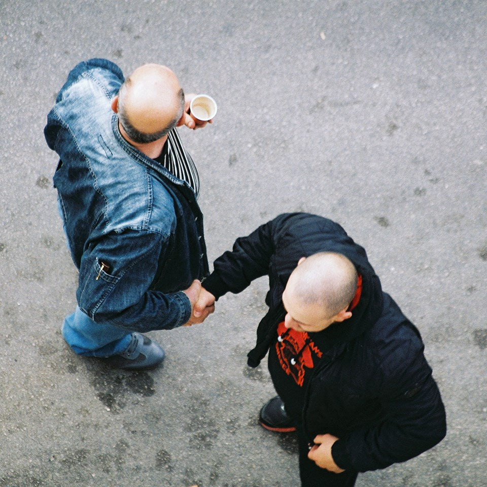 two men gangsters skinheads hand shaking photography by viktor ivanov