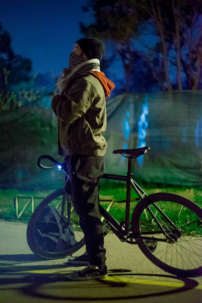 man cycling on a bike at night photography by viktor ivanov