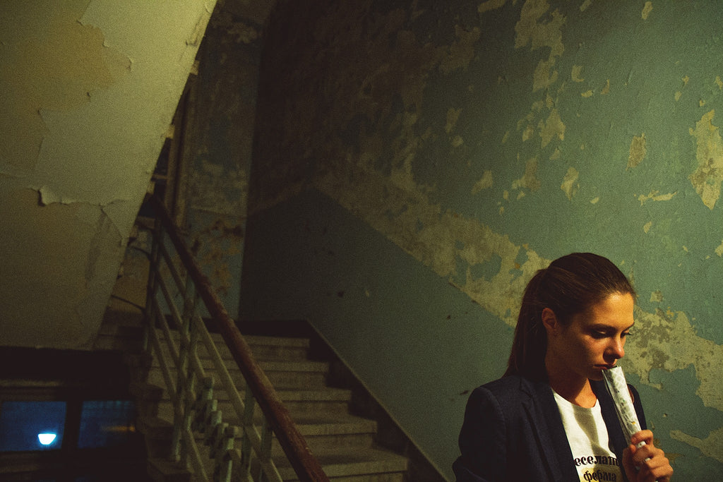 girl on old staircase photography by viktor ivanov