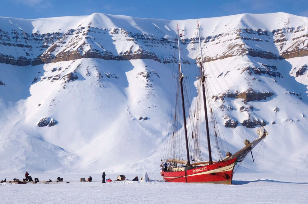On a snow mobile excursion to Tempelfjorden in Spitsbergen, a schooner imprisoned in the frozen fjord