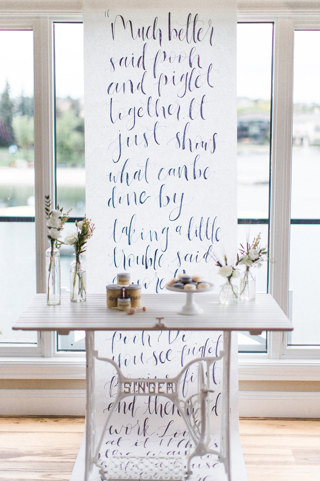 honey_on_table_with_flowers_calligraphy