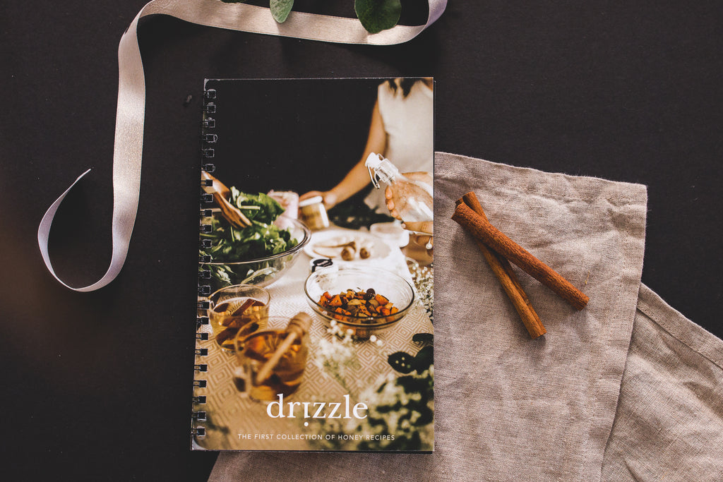 First edition Drizzle Honey Recipe Book laid on a table