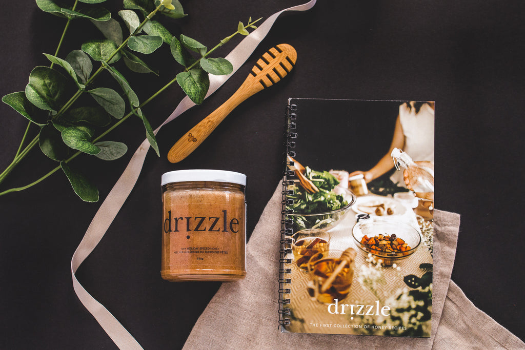 Drizzle Holiday Spiced Honey, Recipe book and honey dipper displayed top down