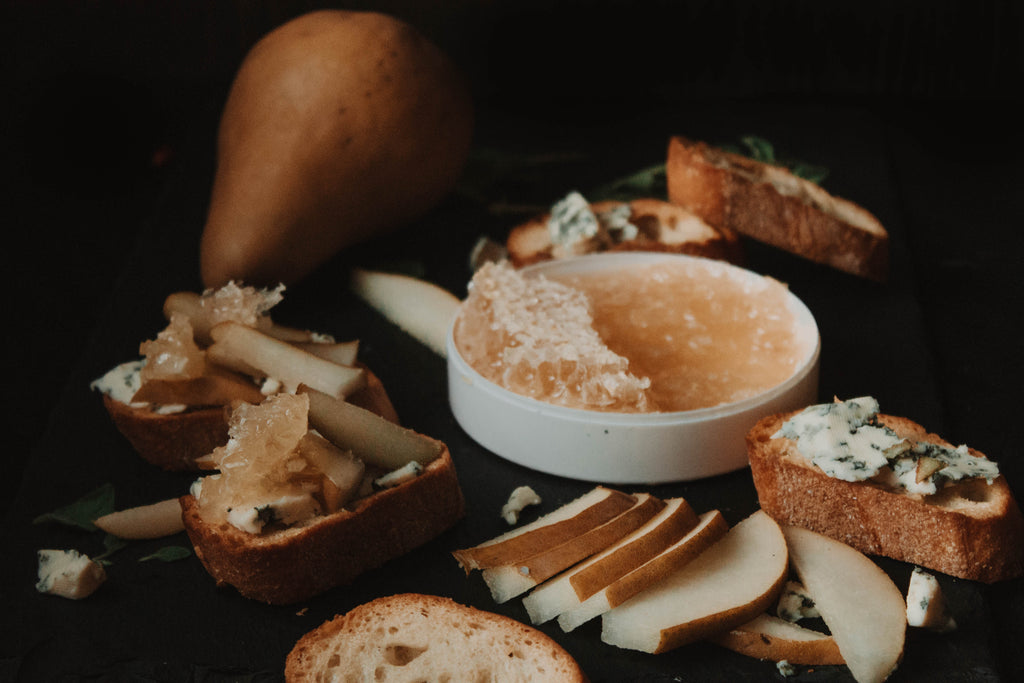 Drizzle Honeycomb, blue cheese and pear crostini appetizer