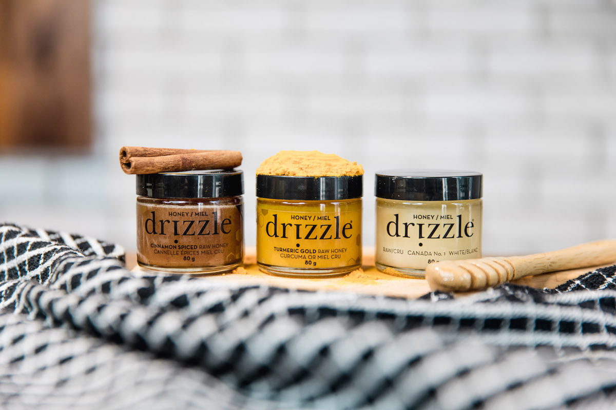 Drizzle Taster Trio next to a drizzle spoon and raw ingredients.