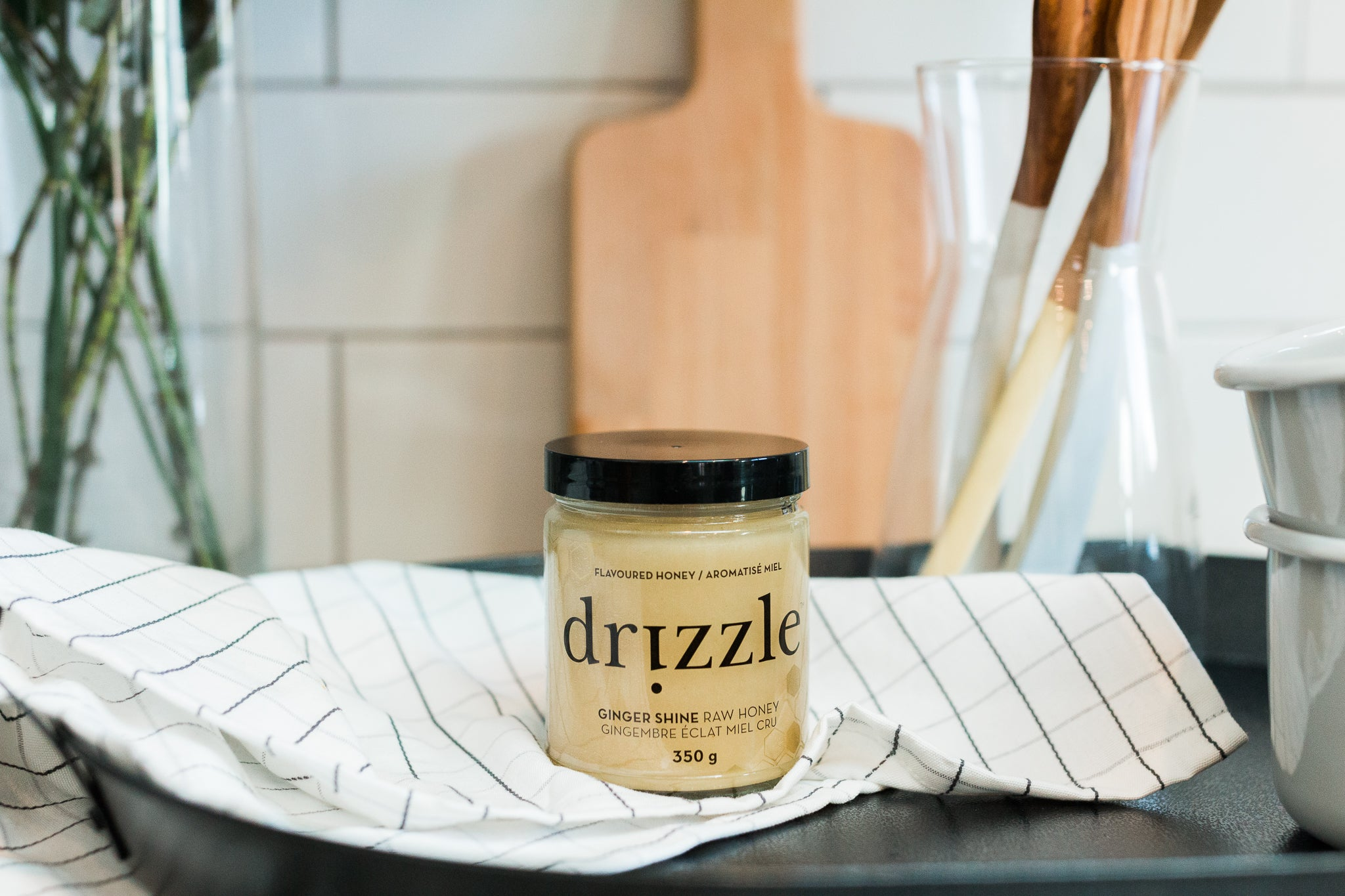 Drizzle Ginger Shine Raw Honey in a kitchen.