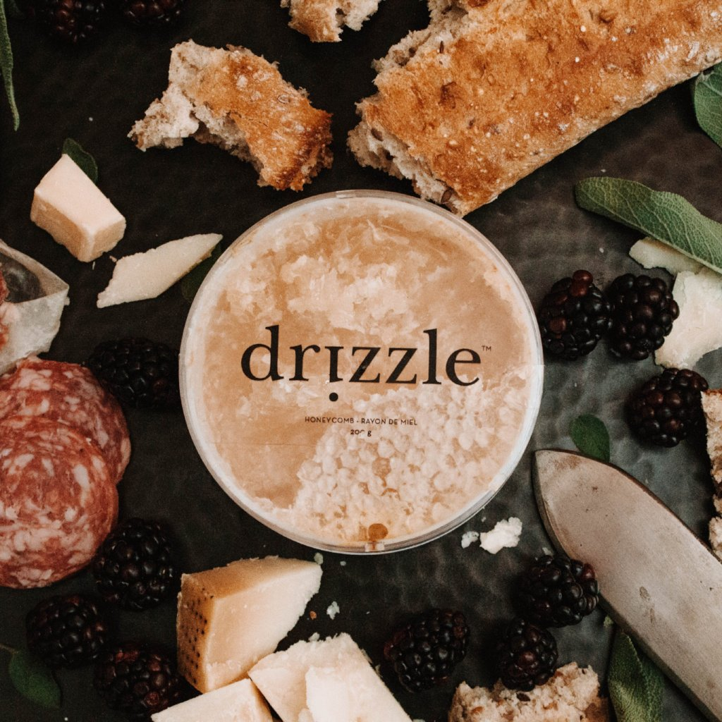 Drizzle Honeycomb in the middle of a luxurious charcuterie board.