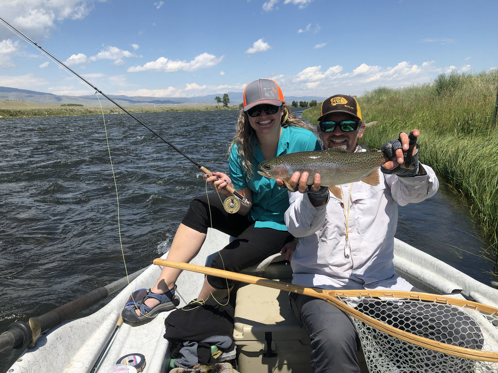 Showing off a beautiful rainbow trout caught on a recent guided fly fishing trip on the Madison River near Ennis Montana.