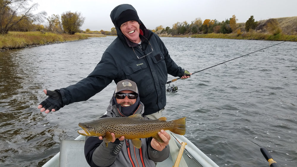 Big Madison River Brown trout caught on spin fishing tackle during a guided float fishing trip on the Upper Madison near Ennis, Montana.