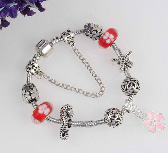 Charm Bracelet With Star Shape and Sea Horse Beads