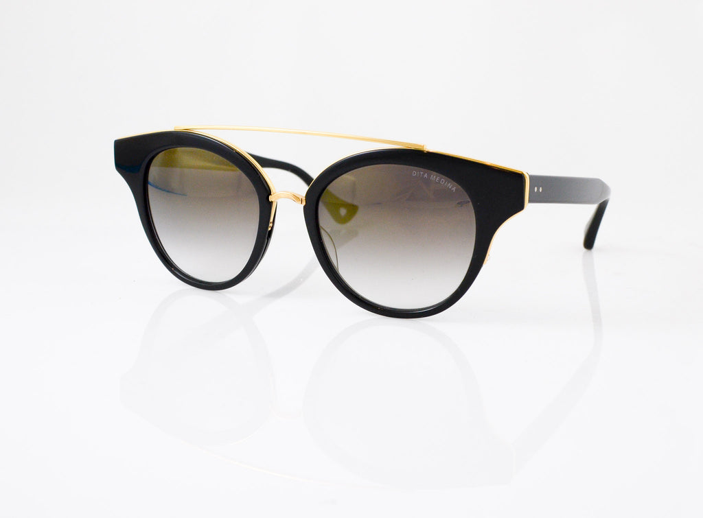 DITA Medina Sunglasses in Black with Shiny 18k Gold, side view, from Specs Optometry