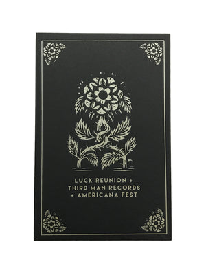 luck mansion poster design of two flowers wrapping together in gold ink on black paper