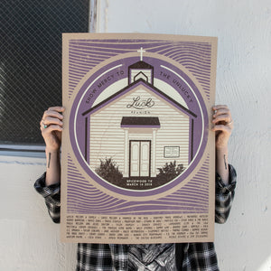 person holding screen printed luck reunion poster from 2019