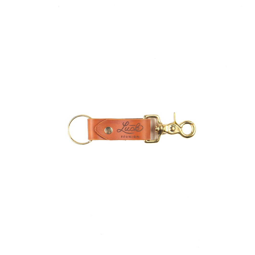 saddle leather key fob branded with luck reunion logo
