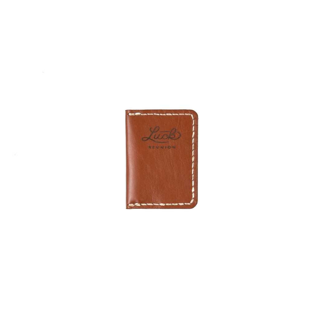 small leather wallet with Luck Reunion logo branded onto the front