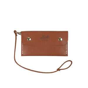 saddle leather wristlet with luck reunion branded logo