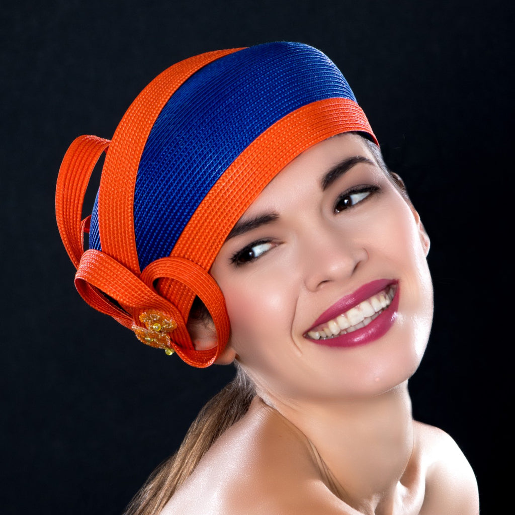 NA0047- Royal blue dress hat with orange trim design and applique
