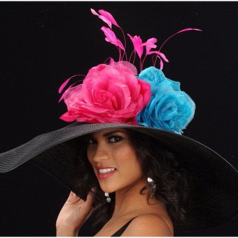 Black straw dress hats with large pink/blue flowers and pink feather
