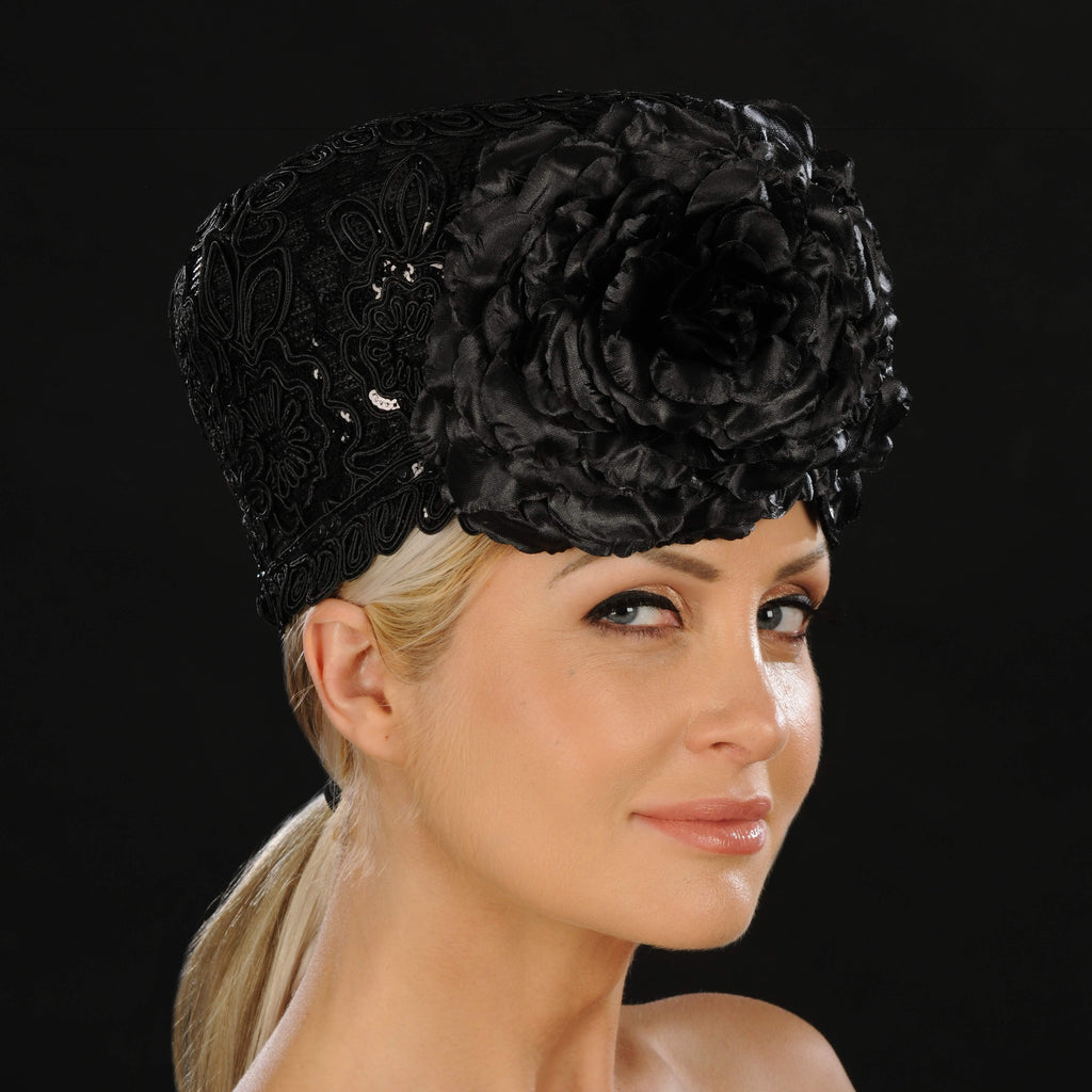 Ladies church hat in black lace fabric and large flowers