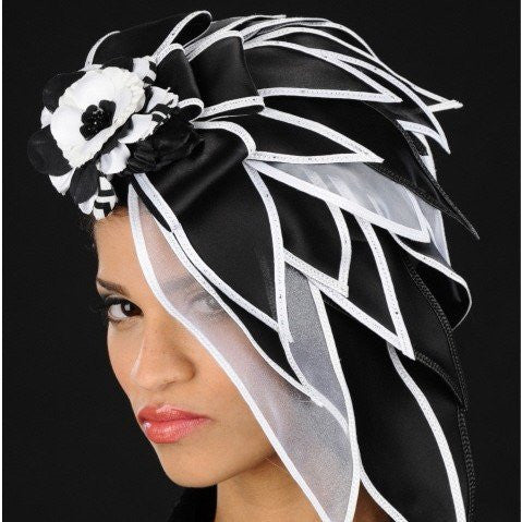ladies fascinators with leaves in black and white
