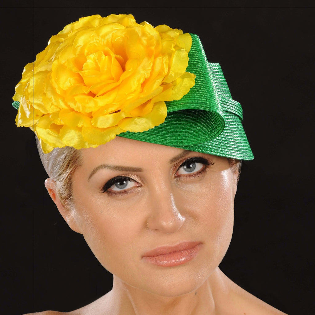 Green straw fascinator with yellow flower