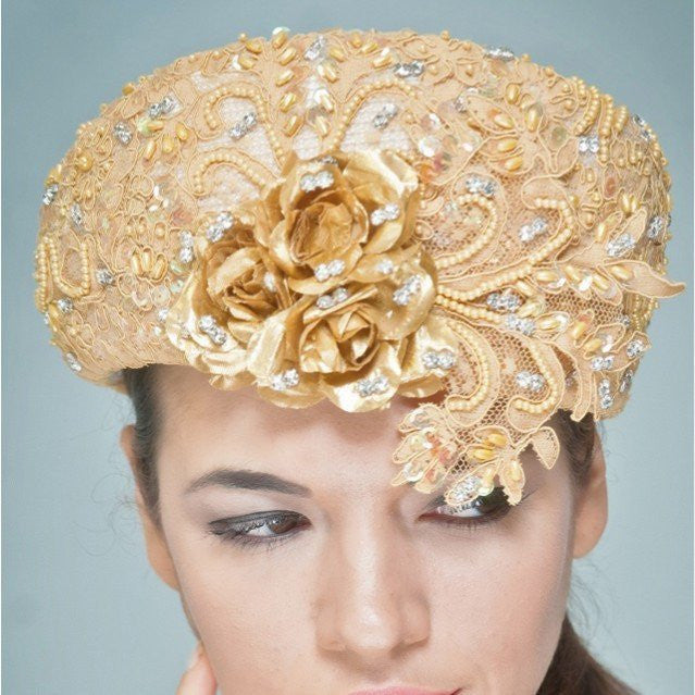 NA1020-Cream dress hat with beaded gold lace fabric and rhinestones - SHENOR COLLECTIONS