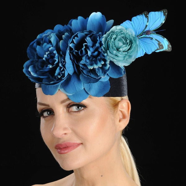 Black straw fascinator with blue flowers and butterfly