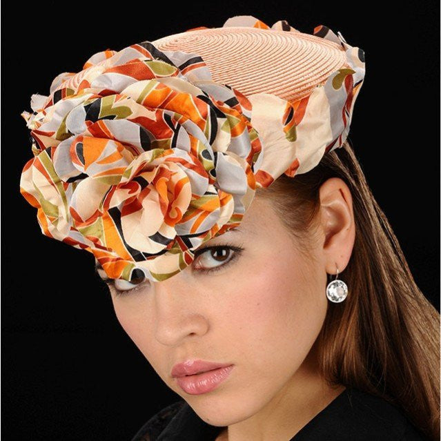 Peach pillbox dress hat covered  with one of a kind flower pebbles