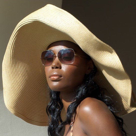 Update your summer style with this tan color wide brim ladies sun hat. Keep it simple and chic with one of our resort big brim hat or beach visor caps.