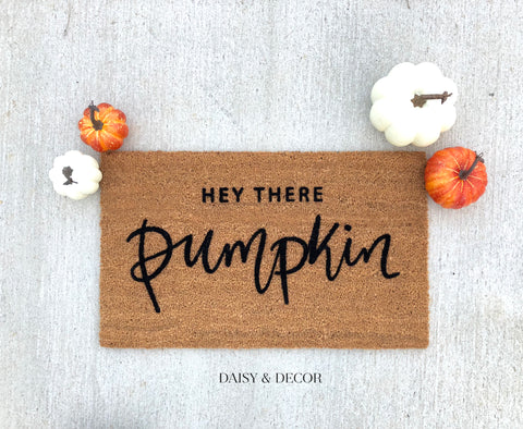 "The perfect addition to your entry way! Make your home feel unique with this handdrawn ""hey there pumpkin"" outdoor doormat!"