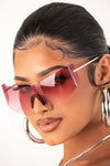 Red Tinted Frameless Sunglasses