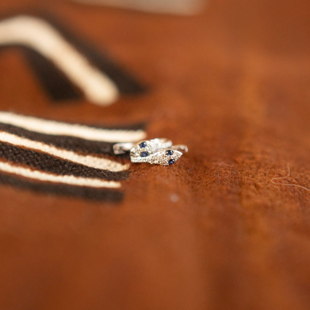 Snake Huggies in White Gold with Blue Sapphire Eyes