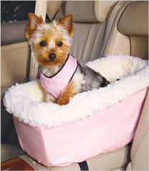 Yorkie riding in console pet car seat