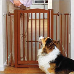 large dog behind Richell One-Touch pet gate
