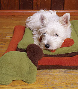 Westie on organic dog pads