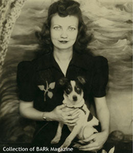 Vintage photo of woman with small dog in lap