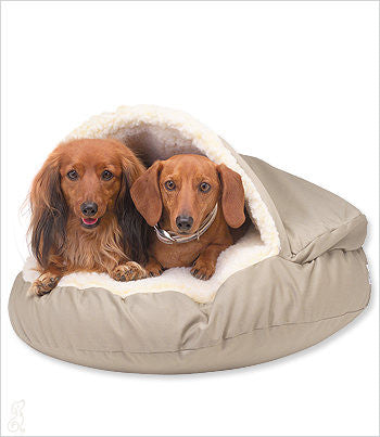 two dachshunds in a cozy cave dog bed