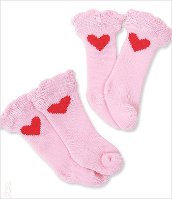 Pink dog socks with red hearts